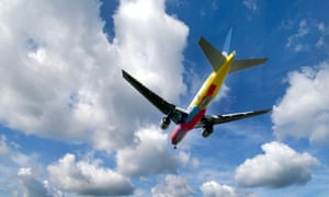 A brightly coloured Continental Airways jet comes in to land at Gatwick