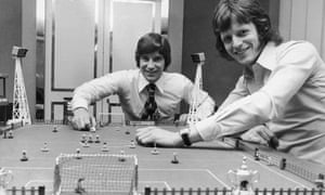 Martin Buchan (left) of Manchester United and Mick Channon of Southampton engage in a game of Subbuteo before facing each other in the upcoming FA Cup Final at Wembley, 27th April 1976.