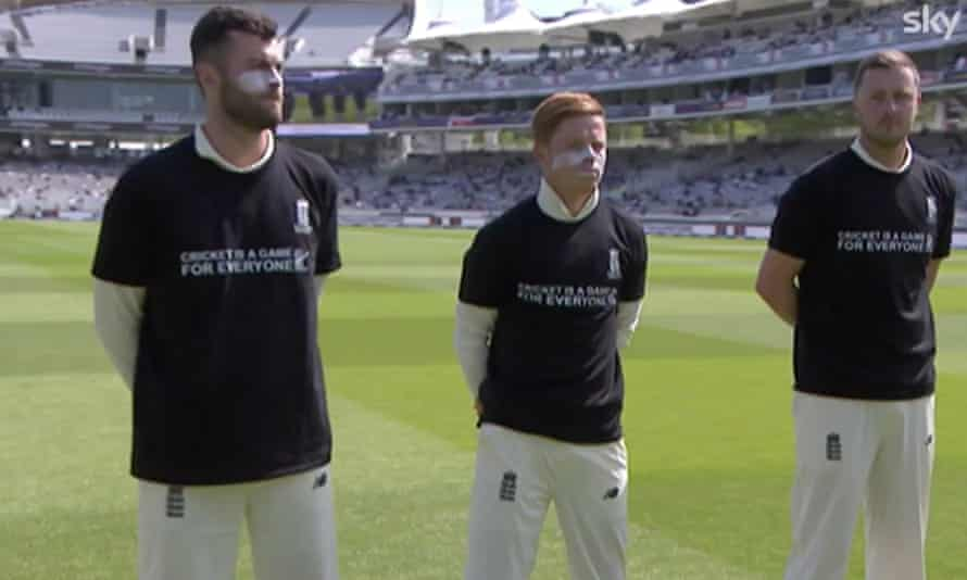 England players, with Ollie Robinson on the right, wear anti-discrimination T-shirts before the start of play at Lord's.