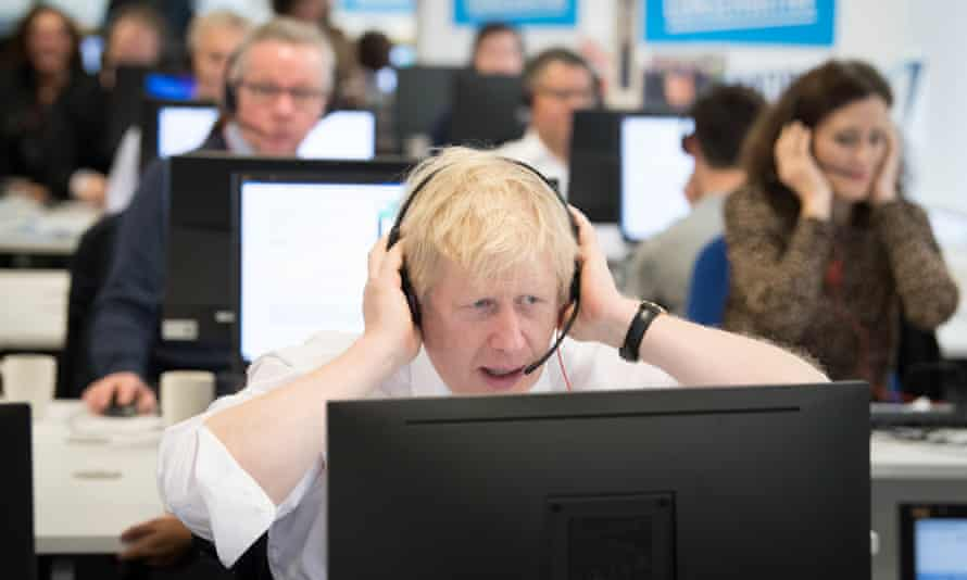 Boris Johnson takes calls at Conservative party campaign headquarters