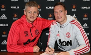 Ole Gunnar Solskjær, left, and Phil Jones, who has signed a new long-term contract at Manchester United.