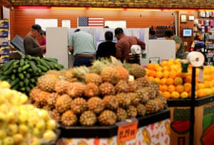 National City, California People cast their ballots at a neighborhood grocery store during voting in the 2016 presidential election