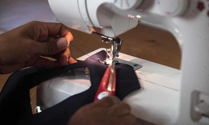 Person using sewing machine