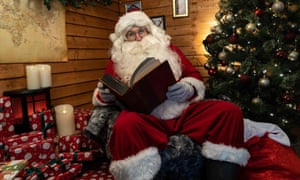 A Santa Claus from Santa's Grotto Live in north London speaks to a family via Zoom
