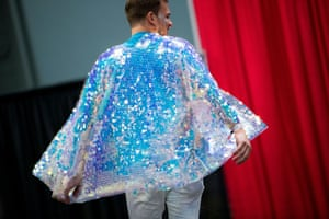An attendee impulsively takes to the runway and dances