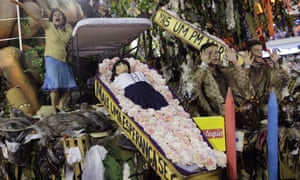 The Beija-Flor samba school performs with a coffin containing a doll representing a dead student.