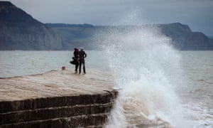 Waves crash against the Cobb.