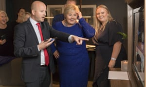 Norway's prime minister, Erna Solberg, centre, with her daughter Ingrid Solberg Finnes and advisor Sgbjorn Aanes watch the election results.