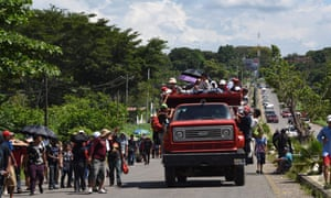 Honduran migrants take part in a caravan heading to the US, in the outskirts of Tapachula, Mexico.