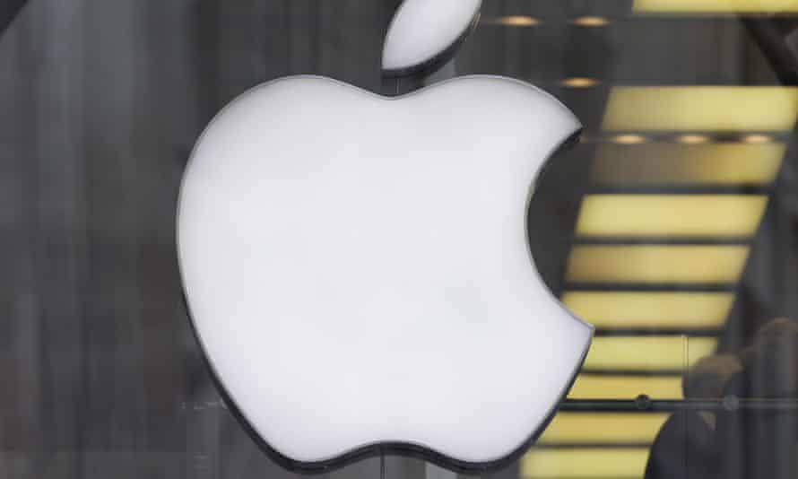 Man walks past Apple logo