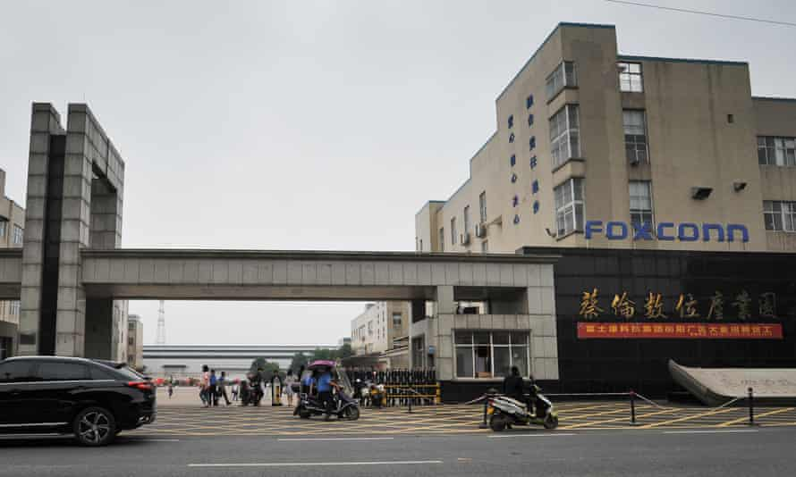 Workers arrive for their shifts at the Foxconn factory in Hengyang