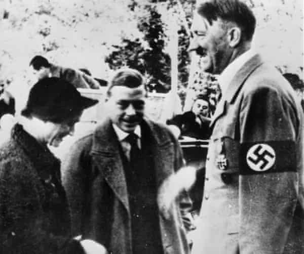 The couple meeting Adolf Hitler in Germany in 1937.