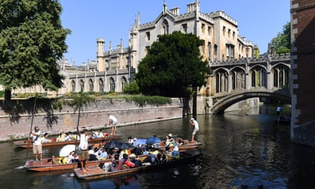 People punt under the Bridge of Sighs at St. John's College in Cambridge on the River Cam