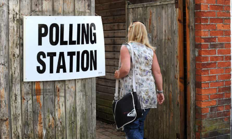 A woman walks into a polling station to vote