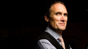 AA Gill photographed at the Milk and Honey Bar in Soho , London .