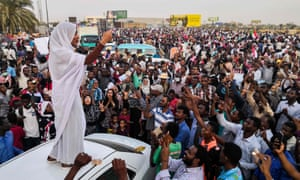 Alaa Salah, a Sudanese woman propelled to internet fame earlier this week after clips went viral of her leading powerful protest chants against the president, addresses protesters in Khartoum on 10 April 10.