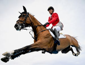 Germany's Daniel Deusser rides Calisto Blue in the nations' cup team jumping event in Aachen, Germany.