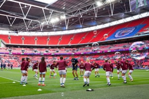 West Ham's players warm up before the match.
