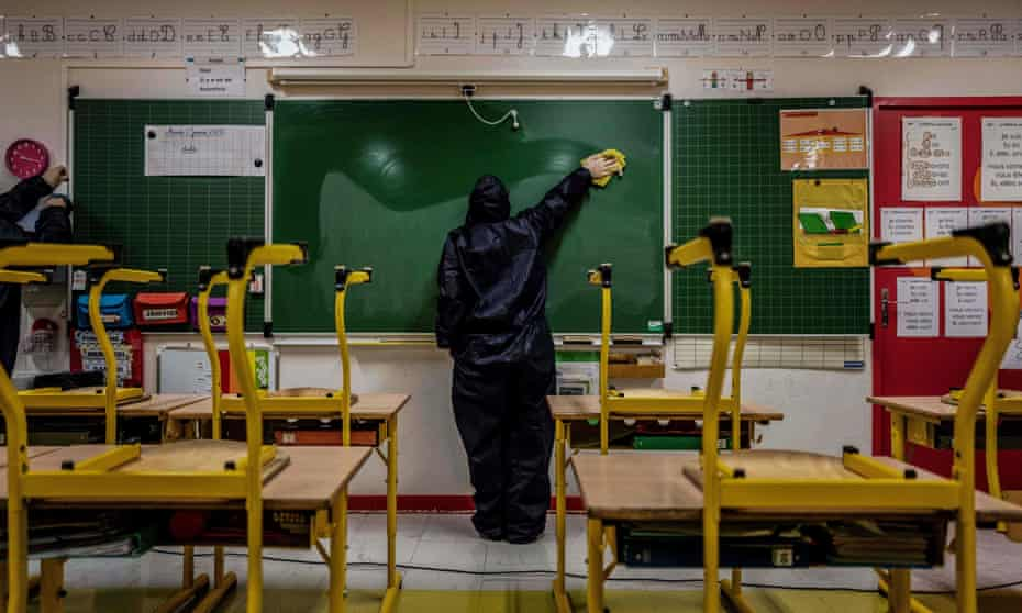 Workers disinfect and clean a classroom in Beaune, France