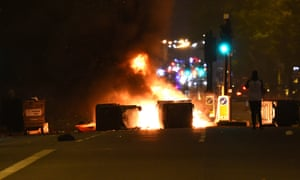 Makeshift road blocks on fire at a protest in Kingsland Road in east London, where people gathered in response to the death of Rashan Charles.
