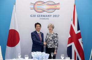 Shinzō Abe, the prime minister of Japan, with Theresa May in Hamburg.
