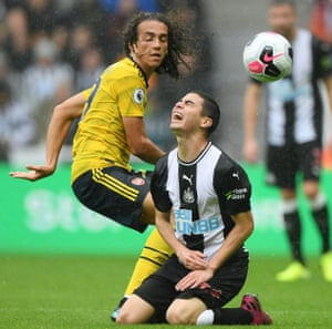 Almiron reacts after being tackled by Guendouzi.