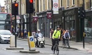 A cyclist runs a red light
