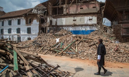 Bhutanese prime minister Tshering Tobgay inspects one of the collapsed temples in Durbar Square