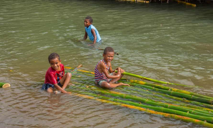 Children playing the river in Fiji