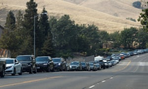Cars line up as people try to evacuate Fairfield 50 miles east of San Francisco on Wednesday.