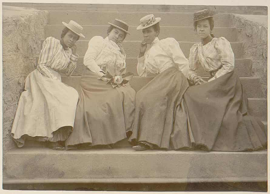 Four African American women seated on the steps of a building at Atlanta University in Georgia