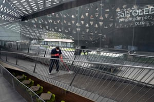 An employee cleans a ramp at the Cineteca Nacional cinema in Mexico City on 4 March, 2021. Mexico City reopened businesses such as cinemas and bars with a 20% capacity and enhanced sanitary measures.