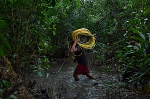 A miner carries plastic tubes