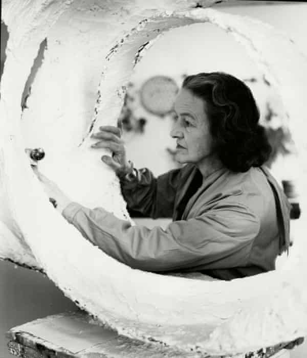 Barbara Hepworth at work on the plaster for Oval Form (Trezion), 1963.
