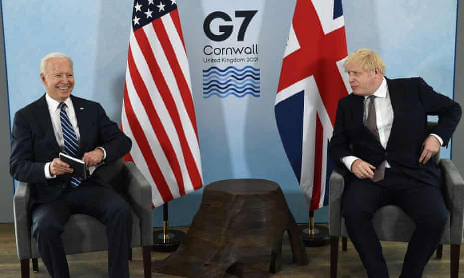 Boris Johnson, right, and the US president, Joe Biden, on stage at a G7 meeting at Carbis Bay, Cornwall.