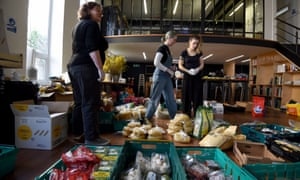 Volunteers from a mutual aid group in Islington, north London, preparing food parcels for members of their community