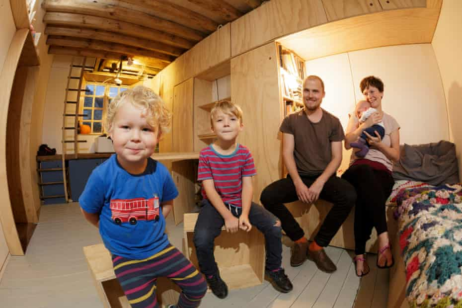 Tom, James, five, Tim Francis, Laura Hubbard-Miles and Edith (eight weeks) in their home's main living area.