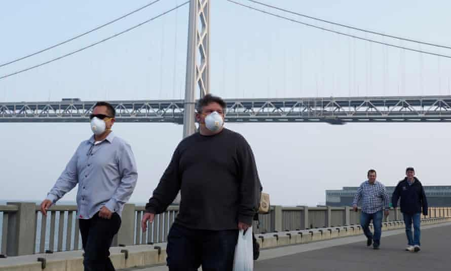 People with masks in San Francisco try to shield themselves from the smokey air brought about by the recent wildfires. Air pollution causes breathing and heart problems.