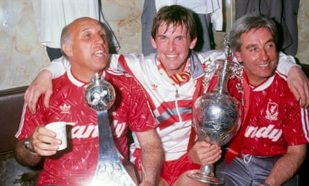 Liverpool in happier times: Kenny Dalglish with Ronnie Moran and Roy Evans after winning the league in 1990.