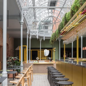 Bar area with its atrium-stylings at Whitworth Locke in Manchester, UK.