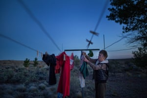 Susie Molloy hangs up her clothes to dry after washing them in fragrance free detergent. Molloy was one of the first people to move to Snowflake.