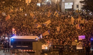 Thousands of Catalans protest against the violence that marred Sunday's referendum vote.