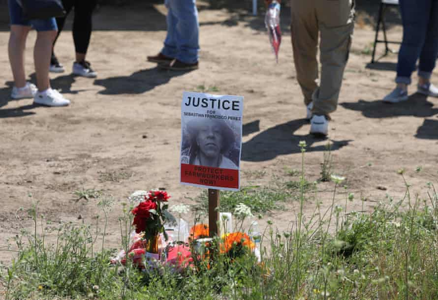 Mourners attend a vigil for Guatemalan-born farmworker Sebastian Francisco Perez, 38, who died St. Paul, Oregon, during the June heatwave.