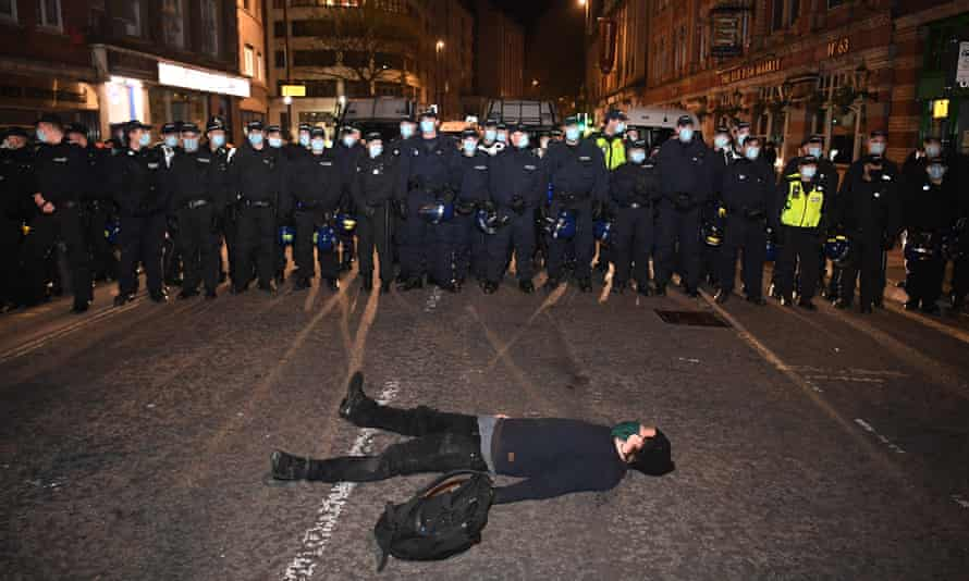 A man lies in the road during the 'kill the bill' protest in Bristol