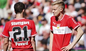 Stuttgart's Benjamin Pavard (left) and Timo Baumgartl look on dejectedly during the 6-0 defeat by Augsburg.
