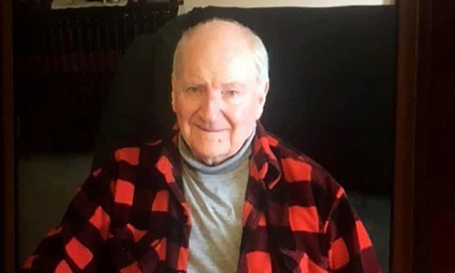 Man in a red and black checked shirt