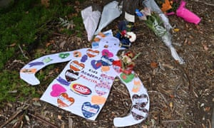 Signs and flowers left at the entrance to Newmarch House aged care home in Sydney.