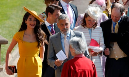 Amal and George Clooney arrive for the royal wedding.