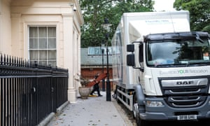 Removal men take out belongings from the foreign secretary's grace-and-favour residence in Carlton Gardens near Buckingham Palace