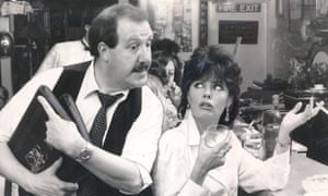 Gorden Kaye as René Artois, the hapless owner of a provincial cafe in Nazi-occupied France, with Vicki Michelle as Yvette, one of the waitresses, in 'Allo 'Allo!, 1986.